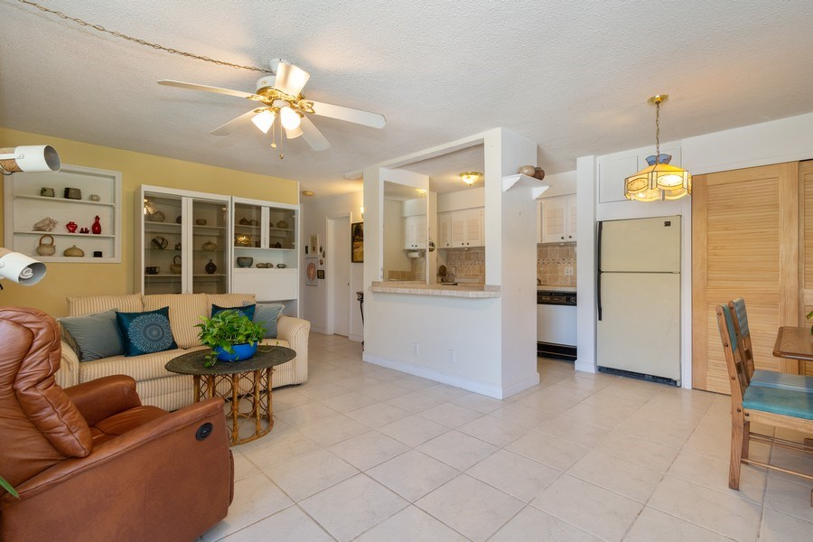Real Estate Photography - 2825 NE 33rd Ave, Unit 103, Fort Lauderdale, FL, 33308 - Kitchen / Living Room
