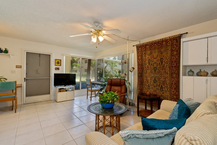 Real Estate Photography - 2825 NE 33rd Ave, Unit 103, Fort Lauderdale, FL, 33308 - Living Room / Dining Room