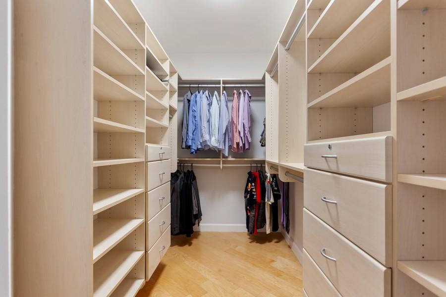 Real Estate Photography - 901 Brickell Key Blvd #2203, Miami, FL, 33131 - Master Bedroom Closet