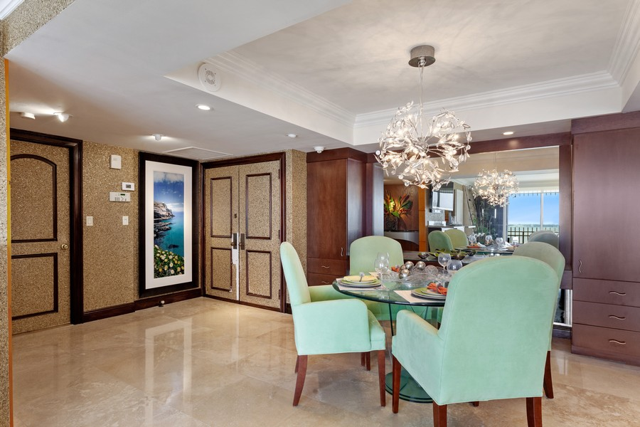 Real Estate Photography - 3 Grove Isle Dr. #C1703, Miami, FL, 33133 - Dining Room