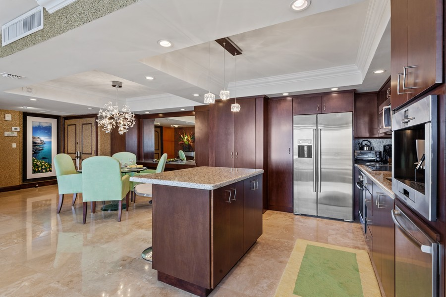 Real Estate Photography - 3 Grove Isle Dr. #C1703, Miami, FL, 33133 - Kitchen / Dining Room