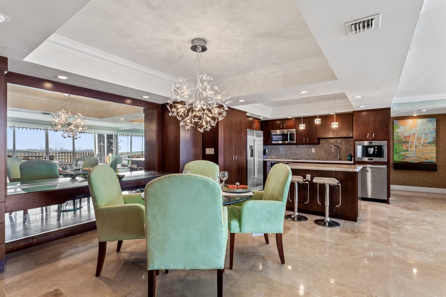 Real Estate Photography - 3 Grove Isle Dr. #C1703, Miami, FL, 33133 - Kitchen/Dining