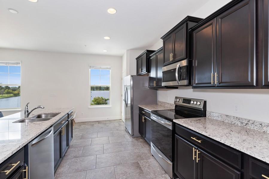 Real Estate Photography - 10562 Green Ivy Lane, Orlando, FL, 32832 - Kitchen