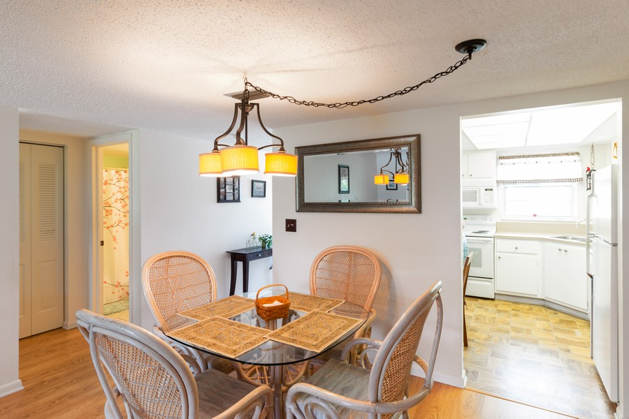 Real Estate Photography - 18081 SE Country Club Drive #303, Tequesta, FL, 33469 - Dining Room