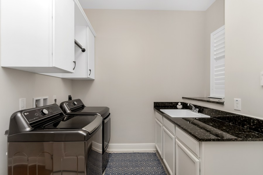 Real Estate Photography - 1345 Tappie Toorie Circle, Lake Mary, FL, 32746 - Laundry Room