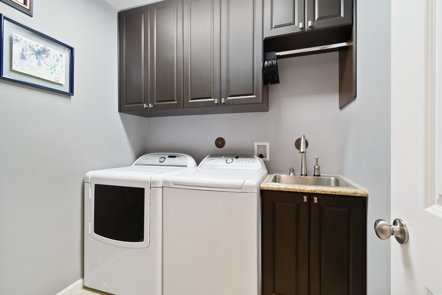 Real Estate Photography - 12660 NW 32nd Manor, Sunrise, FL, 33323 - Laundry Room
