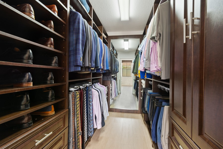 Real Estate Photography - 12660 NW 32nd Manor, Sunrise, FL, 33323 - Master Bedroom Closet