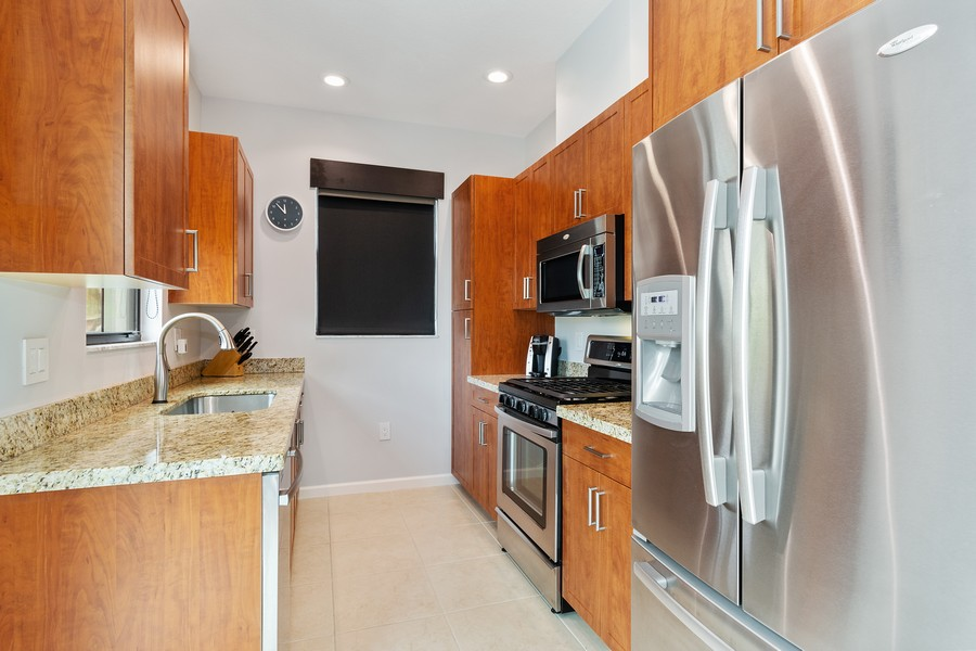 Real Estate Photography - 12660 NW 32nd Manor, Sunrise, FL, 33323 - Kitchen
