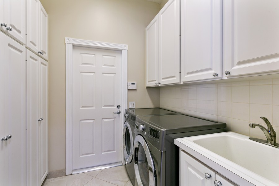 Real Estate Photography - 2705 Hancock Creek Road, West Palm Beach, FL, 33411 - Laundry Room