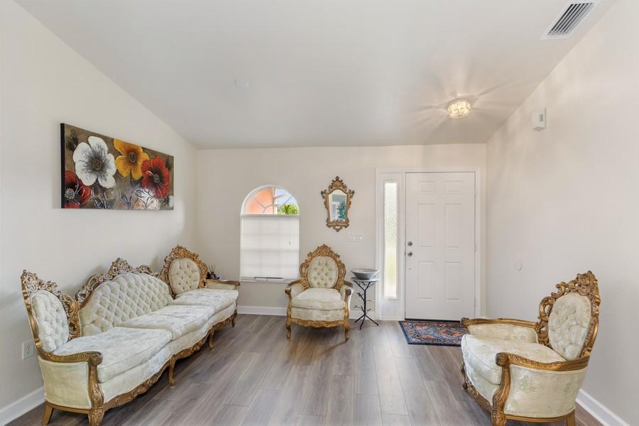 Real Estate Photography - 728 Cane Street East, Lehigh Acres, FL, 33974 - Living Room
