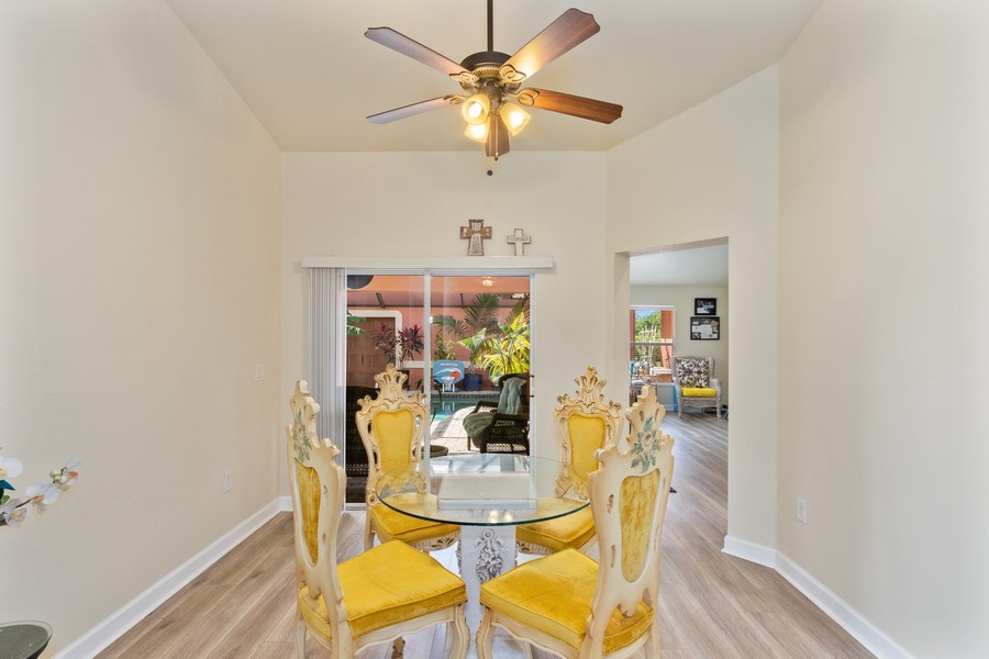 Real Estate Photography - 728 Cane Street East, Lehigh Acres, FL, 33974 - Dining Room