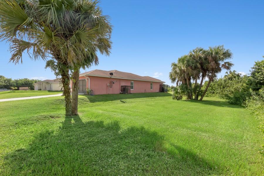 Real Estate Photography - 728 Cane Street East, Lehigh Acres, FL, 33974 - Side Yard