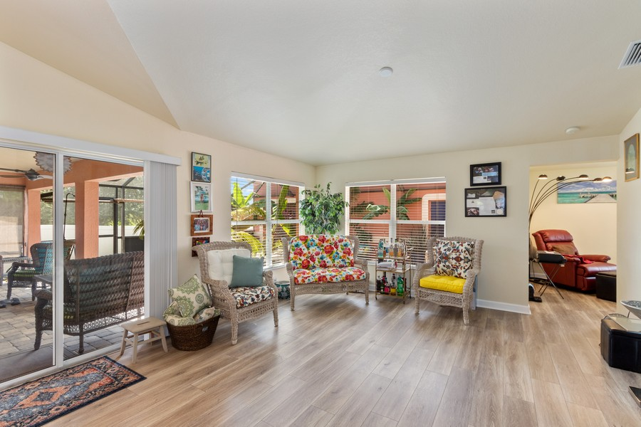 Real Estate Photography - 728 Cane Street East, Lehigh Acres, FL, 33974 - Family Room