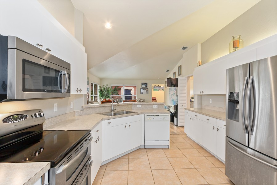 Real Estate Photography - 728 Cane Street East, Lehigh Acres, FL, 33974 - Kitchen
