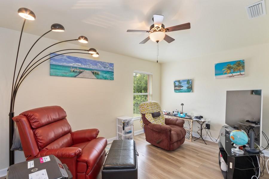 Real Estate Photography - 728 Cane Street East, Lehigh Acres, FL, 33974 - Den