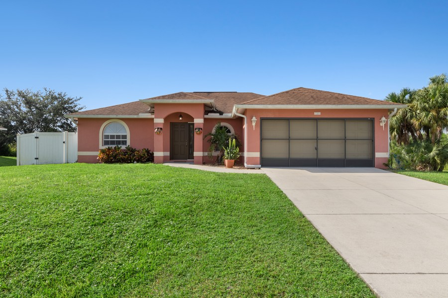 Real Estate Photography - 728 Cane Street East, Lehigh Acres, FL, 33974 - Front View
