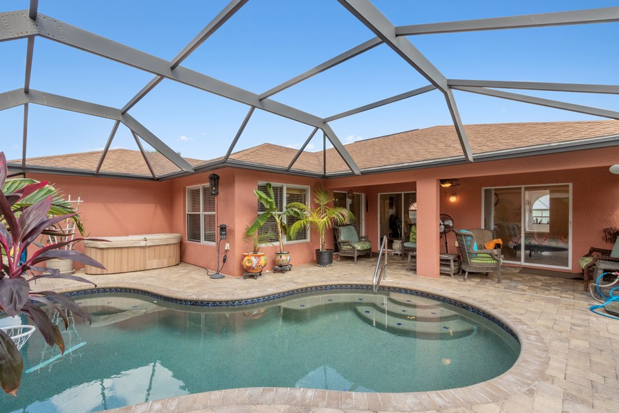 Real Estate Photography - 728 Cane Street East, Lehigh Acres, FL, 33974 - Rear View