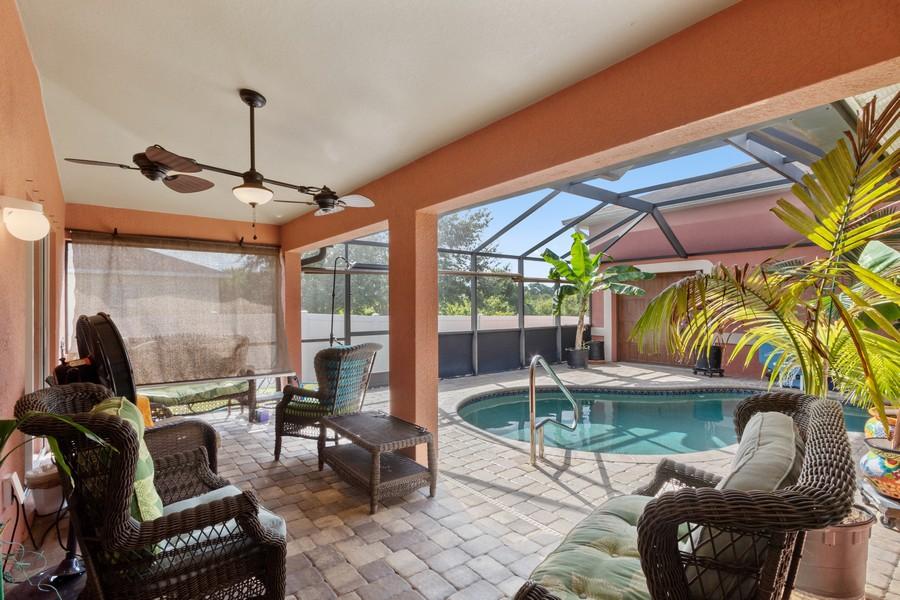 Real Estate Photography - 728 Cane Street East, Lehigh Acres, FL, 33974 - Lanai