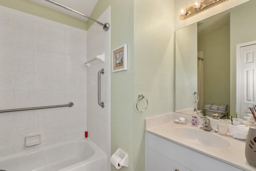 Real Estate Photography - 728 Cane Street East, Lehigh Acres, FL, 33974 - 2nd Bathroom