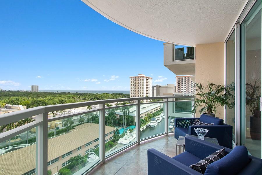 Real Estate Photography - 2845 NE 9th St, Unit 905, Fort Lauderdale, FL, 33304 - Terrace off Living Room-Ocean, Canal & Park Views