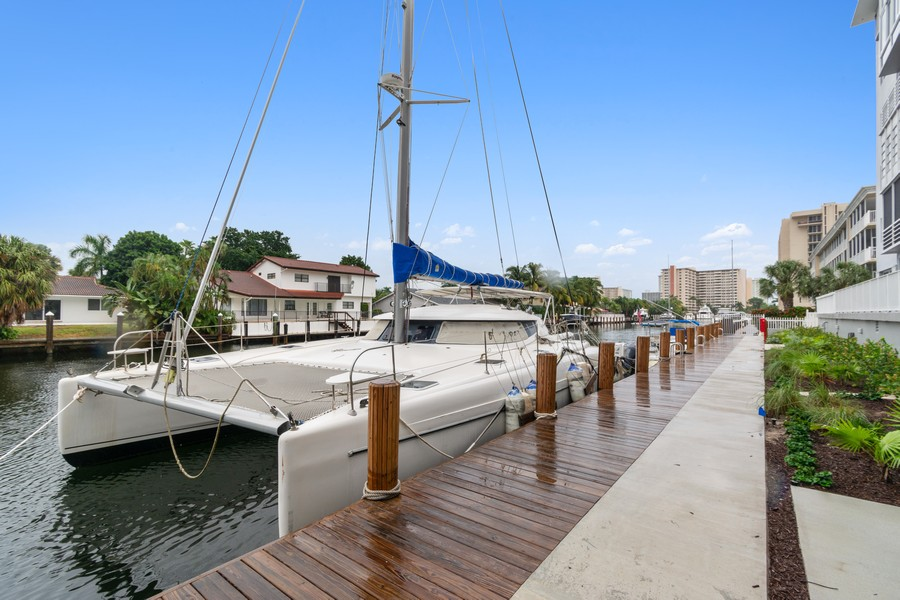 Real Estate Photography - 2829 NE 33 Ct, Unit 401, Fort Lauderdale, FL, 33306 - New Dock and Landscaping Looking East