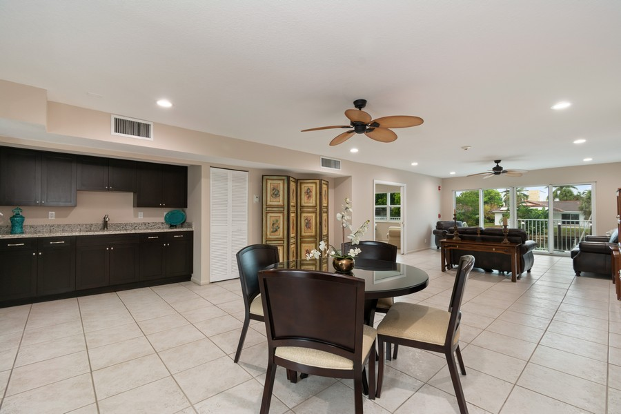 Real Estate Photography - 2829 NE 33 Ct, Unit 401, Fort Lauderdale, FL, 33306 - Clubroom with Kitchen Area