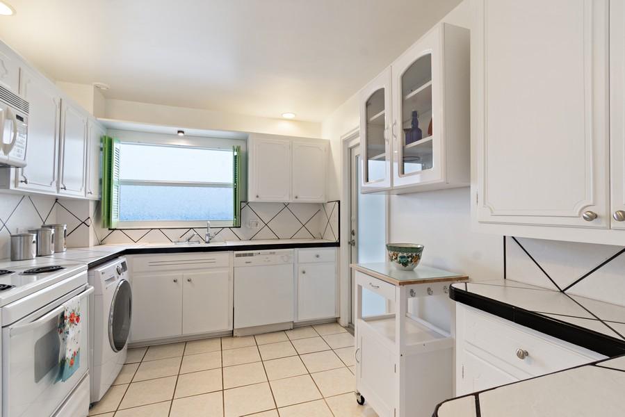 Real Estate Photography - 2829 NE 33 Ct, Unit 401, Fort Lauderdale, FL, 33306 - Kitchen