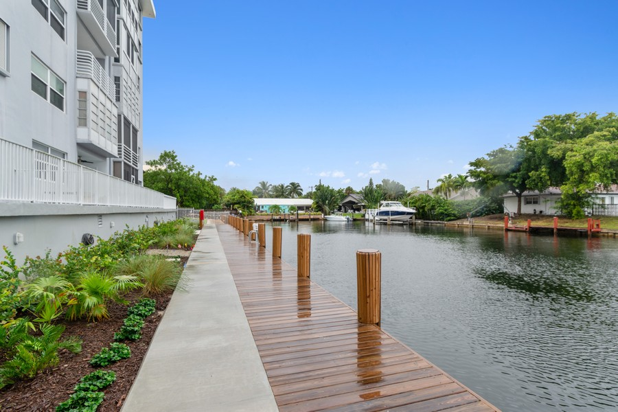 Real Estate Photography - 2829 NE 33 Ct, Unit 401, Fort Lauderdale, FL, 33306 - New Dock and Landscaping Looking West