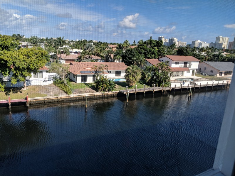 Real Estate Photography - 2829 NE 33 Ct, Unit 401, Fort Lauderdale, FL, 33306 - Living Room/Terace View