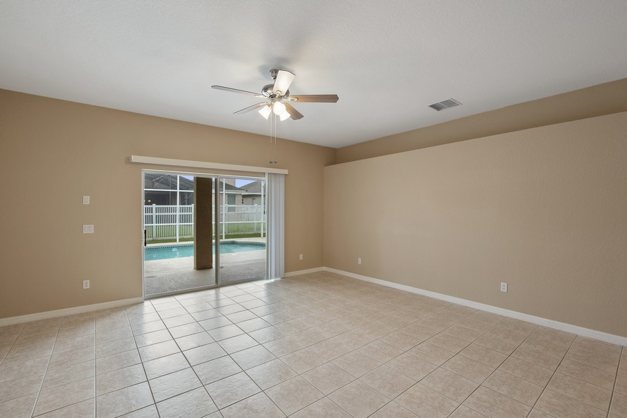 Real Estate Photography - 9945 MOUNTAIN LAKE DRIVE, ORLANDO, FL, 32832 - FAMILY ROOM OVERLOOKING POOL