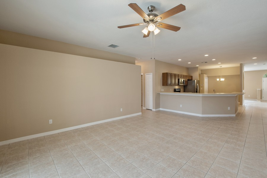Real Estate Photography - 9945 MOUNTAIN LAKE DRIVE, ORLANDO, FL, 32832 - FAMILY ROOM AND OPEN KITCHEN