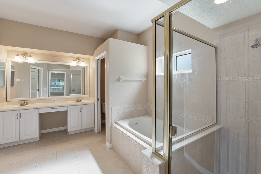 Real Estate Photography - 9945 MOUNTAIN LAKE DRIVE, ORLANDO, FL, 32832 - MASTER BATHROOM WITH JACUZZI TUB AND SHOWER