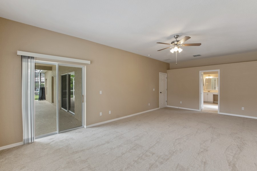 Real Estate Photography - 9945 MOUNTAIN LAKE DRIVE, ORLANDO, FL, 32832 - MASTER RETREAT WITH SLIDERS OPENING TO POOL