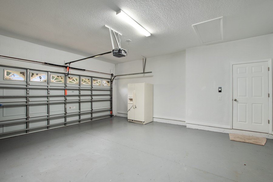 Real Estate Photography - 9945 MOUNTAIN LAKE DRIVE, ORLANDO, FL, 32832 - TWO GARAGE WITH FINISHED FLOORING