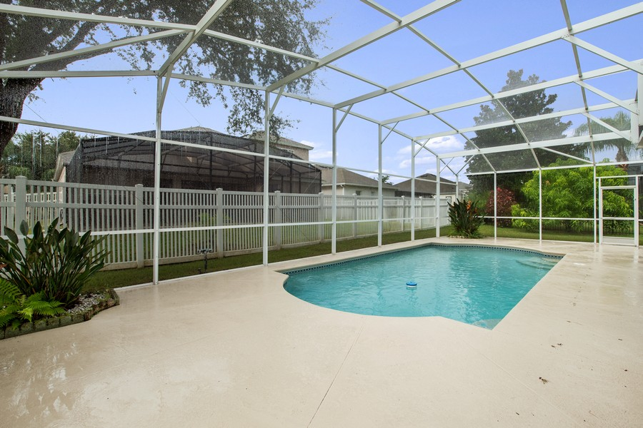 Real Estate Photography - 9945 MOUNTAIN LAKE DRIVE, ORLANDO, FL, 32832 - SCREENED POOL WITH SUNNING DECK
