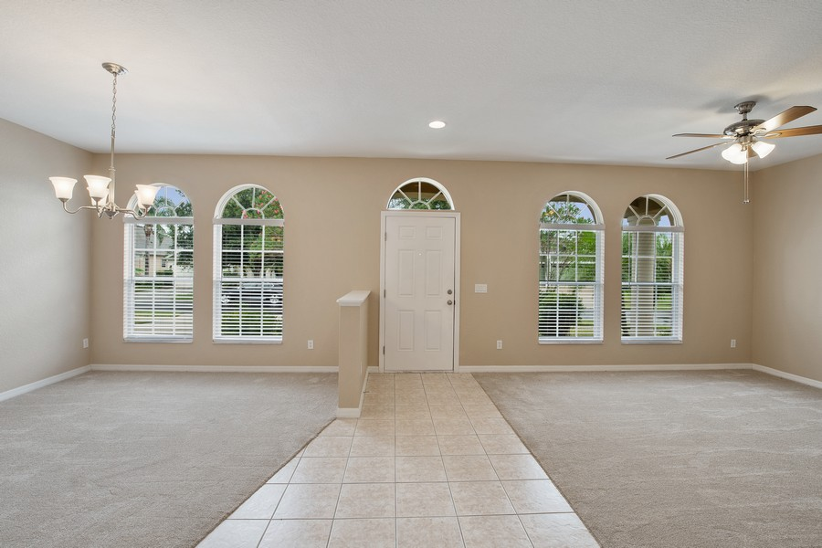 Real Estate Photography - 9945 MOUNTAIN LAKE DRIVE, ORLANDO, FL, 32832 - FOYER, FORMAL LIVING AND DINING ROOMS