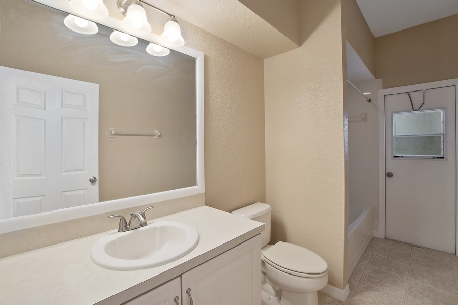Real Estate Photography - 9945 MOUNTAIN LAKE DRIVE, ORLANDO, FL, 32832 - GUEST BATHROOM WITH POOL ACCESS