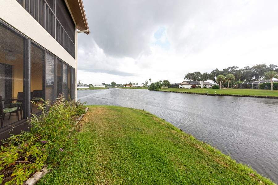 Real Estate Photography - 1783 Lake Pl, 1793-A, Venice, FL, 34292 - Canal View