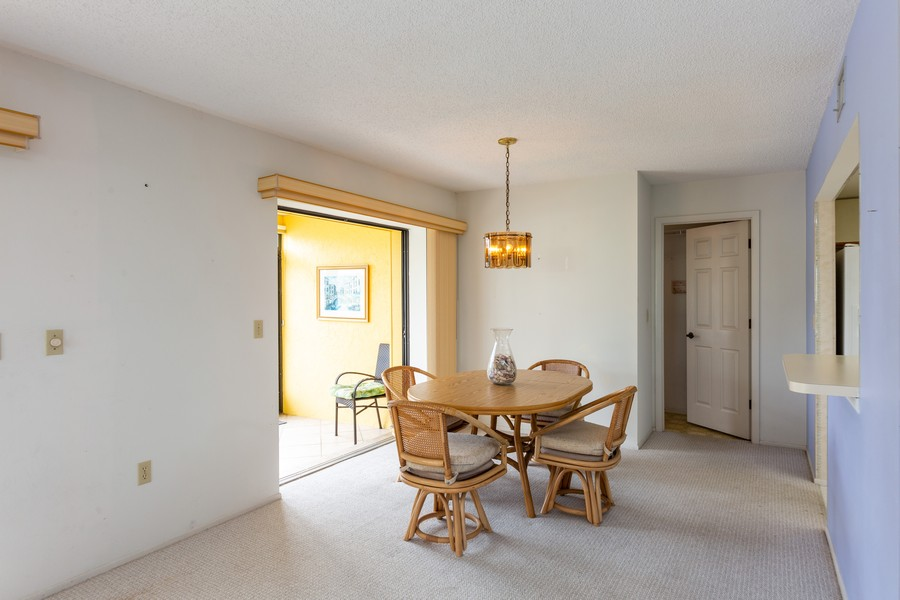 Real Estate Photography - 1783 Lake Pl, 1793-A, Venice, FL, 34292 - Dining Area