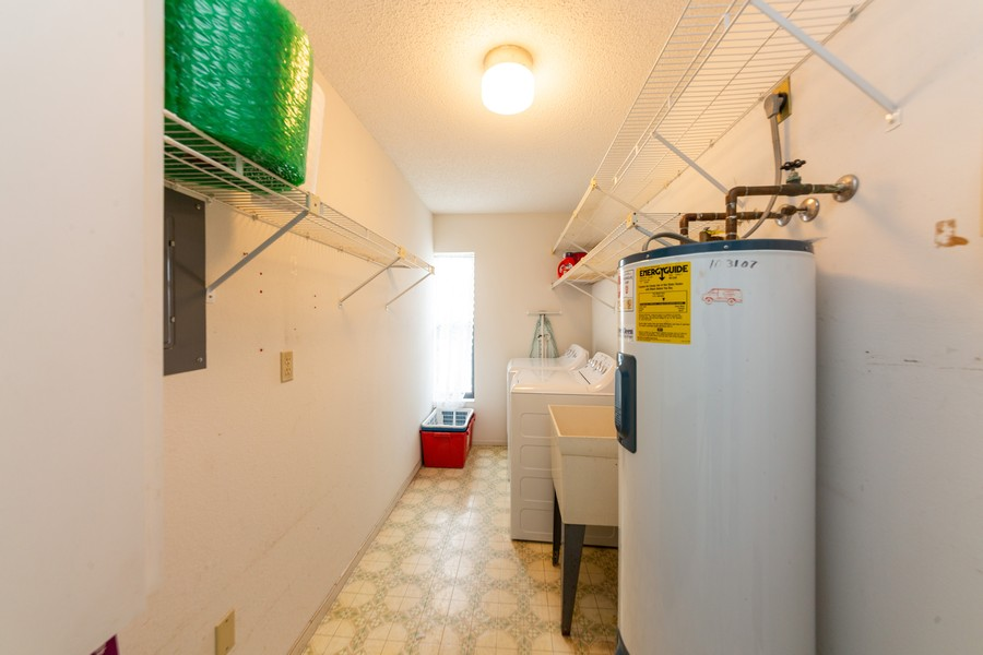 Real Estate Photography - 1783 Lake Pl, 1793-A, Venice, FL, 34292 - Laundry Room