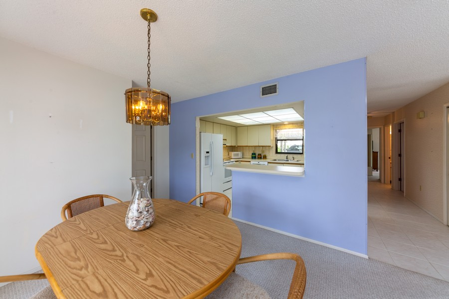 Real Estate Photography - 1783 Lake Pl, 1793-A, Venice, FL, 34292 - Kitchen / Dining Room