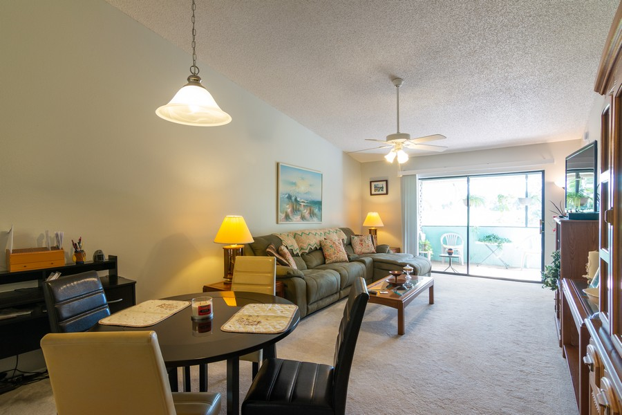 Real Estate Photography - 3607 Longmeadow, 45, Sarasota, FL, 34235 - Living Room / Dining Room