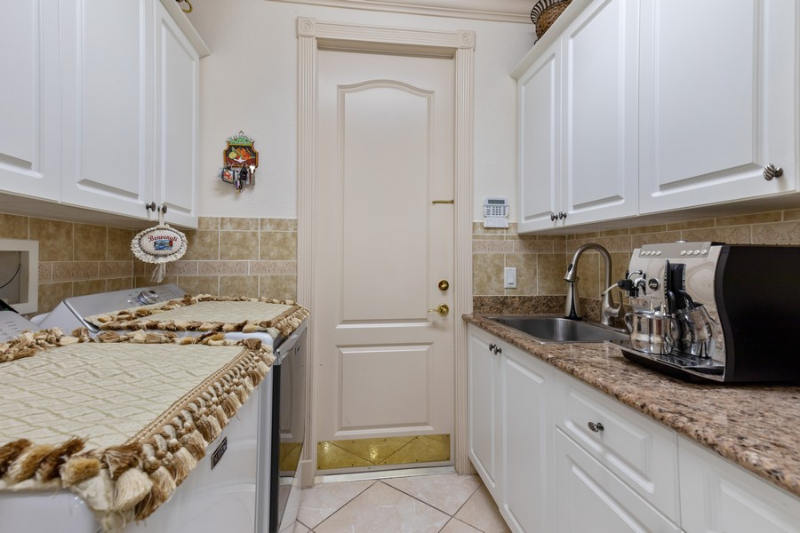 Real Estate Photography - 22 Madison Dr, Naples, FL, 34110 - Laundry Room