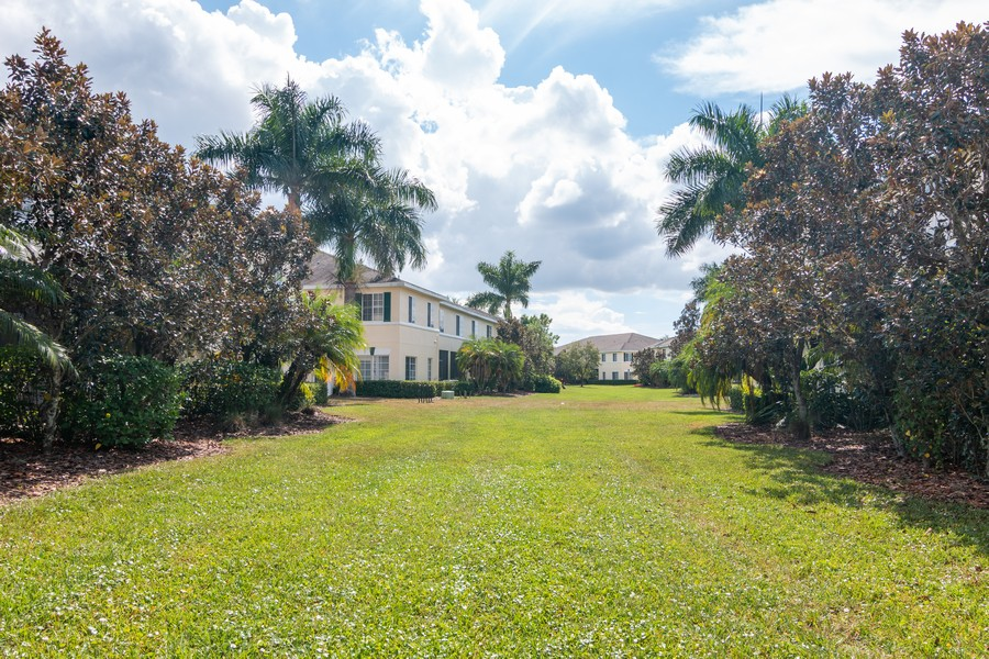 Real Estate Photography - 239 Cape Harbour Loop, Unit 103, Bradenton, FL, 34212 - Back Yard