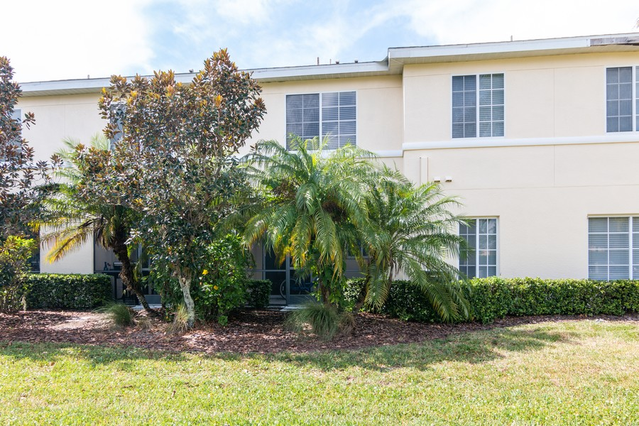 Real Estate Photography - 239 Cape Harbour Loop, Unit 103, Bradenton, FL, 34212 - Rear View