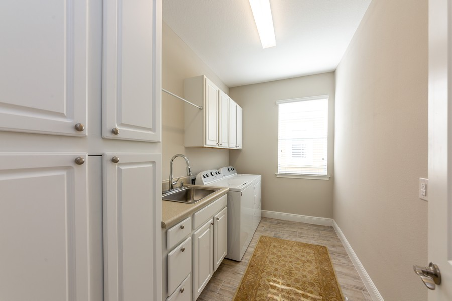 Real Estate Photography - 11660 Tapestry Lane, Venice, FL, 34293 - Laundry Room