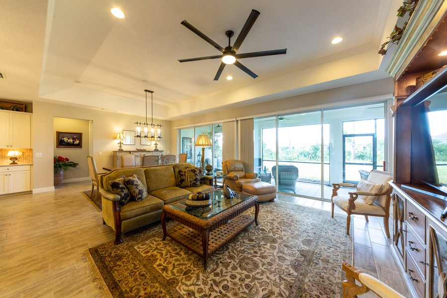 Real Estate Photography - 11660 Tapestry Lane, Venice, FL, 34293 - Family Room / Dining Room