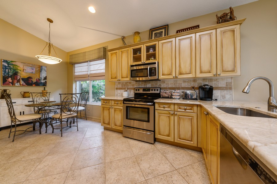 Real Estate Photography - 8775 Palm River Dr, Lake Worth, FL, 33467 - Kitchen / Breakfast Room