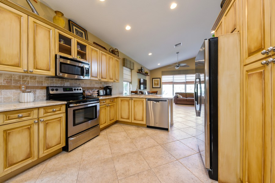 Real Estate Photography - 8775 Palm River Dr, Lake Worth, FL, 33467 - Family Room / Kitchen
