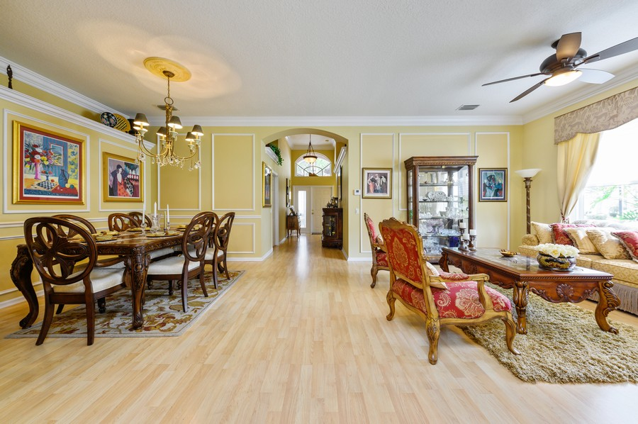 Real Estate Photography - 7581 Lake Harbor Terrace, Lake Worth, FL, 33467 - Living Room / Dining Room